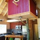 The Birdhouse is Located in the Center of the Chalet and is Built around a Real Tree