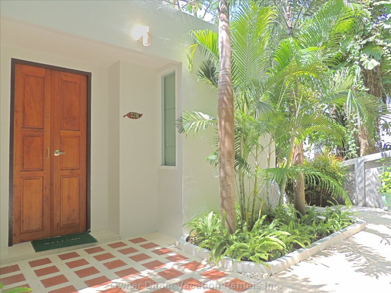 Apartment Entrance Just Steps from the Pool and Beach down a Garden Path - Similar to but May Not be Exact Unit.