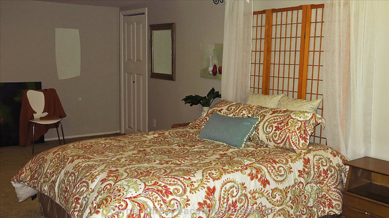 1st Bedroom with Queen Bed and Room for Extra Sleeping Mat