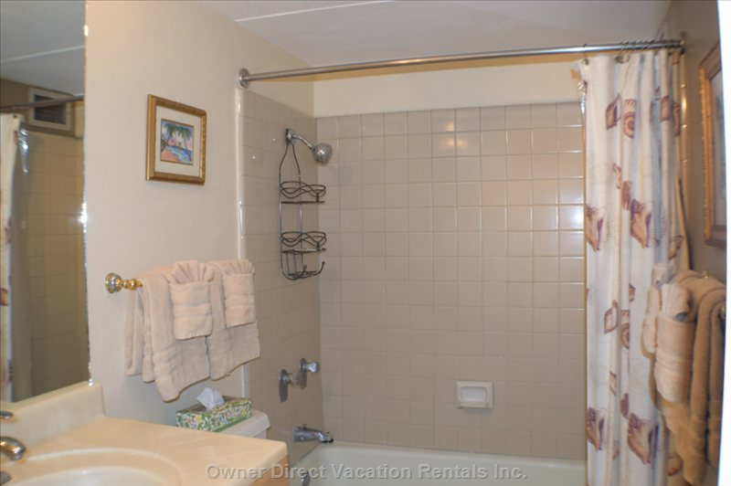 Main Bathroom that has a Tub and Shower Combination.