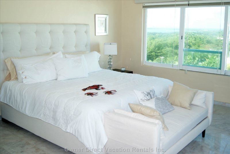 Comfortable King Sized Bed with Ocean and Lagoon Views