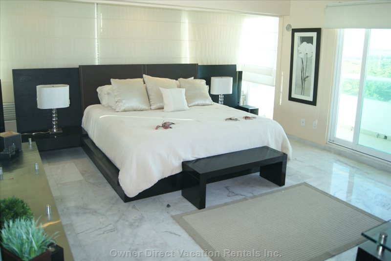 Guest Bedroom 1 with King Size Bed and Lagoon Views