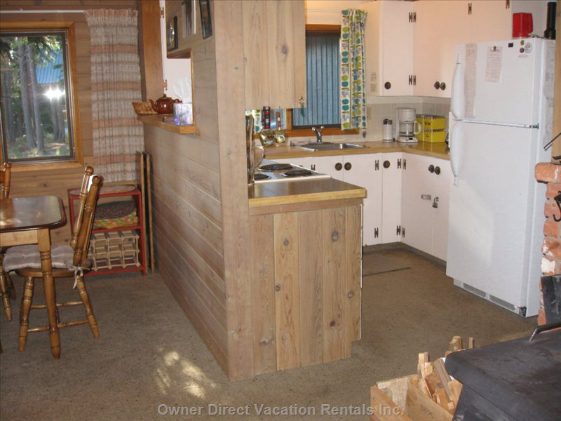 Well Equipped Kitchen with Dining Room Also Visible