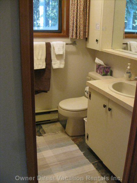 Bathroom, the Tub and Shower Are out of Sight behind the Door