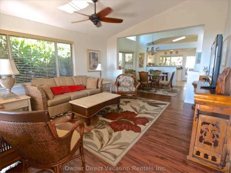 Sunny Living Area has Large Flat Screen Tv and Beautiful Ocean View