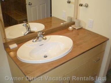 Wood Bathroom Counters Are a Nice Touch, Warm and Rich!