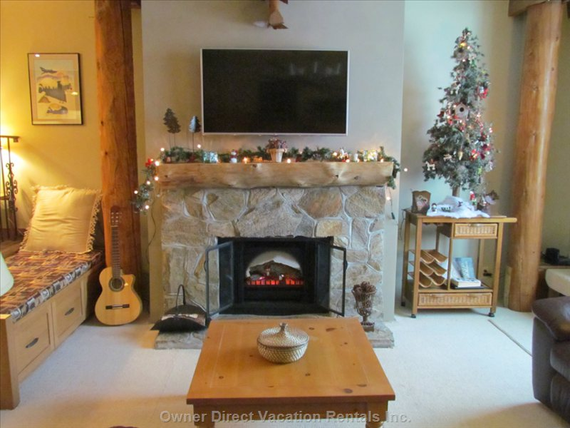 Stone Fireplace with Electric Insert.  Great Ambiance in this Cozy Unit.