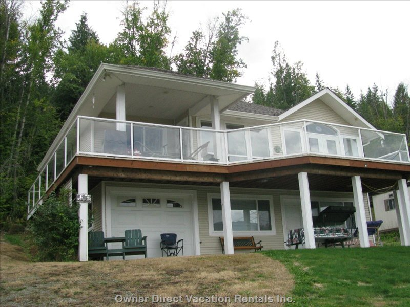 Large Open Deck with a Gorgeous Unobstructed View of the Beach and Lots of Room for Kids to Play. Two Patio Tables and Lots of Chairs.