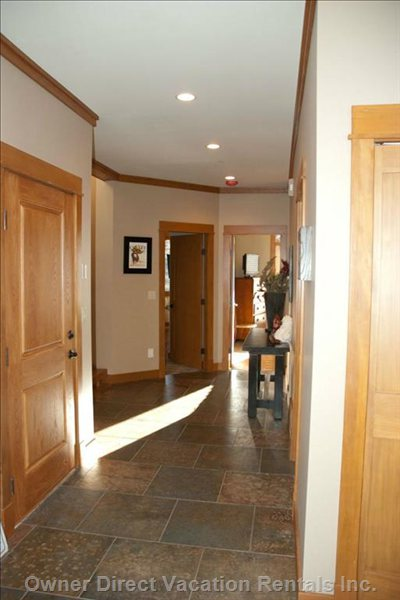 Main Level Entrance Hall - Front Door and Garage Entry on this Level, Laundry to the Right and Two Master Bedrooms at the End of the Hallway.
