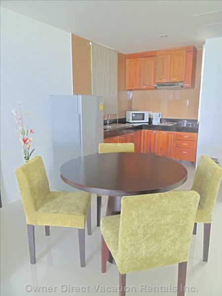 Dining Area and Fully Equipped Kitchen to Make yourself at Home - Similar to but May Not be Exact Unit.