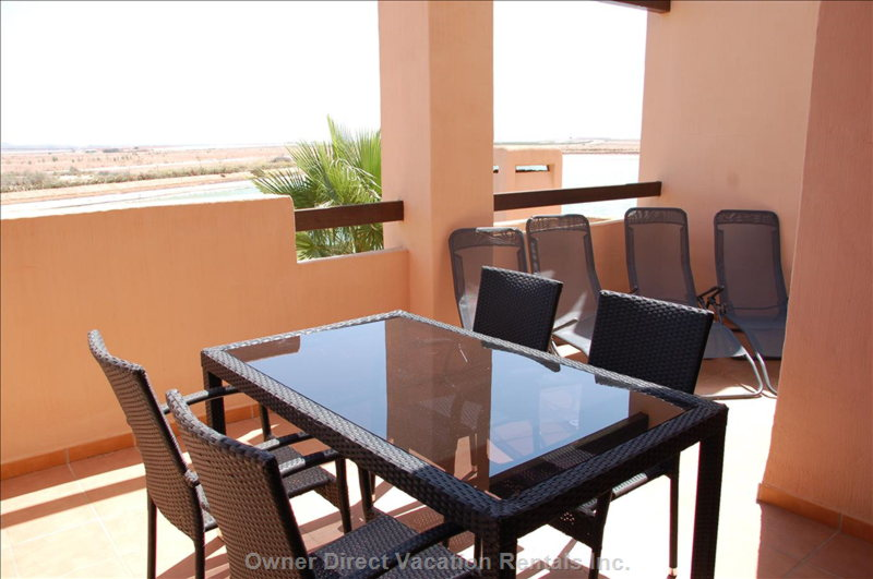 The Balcony has an Outside Table with 4 Chairs as well as 4 Lightweight Sun Loungers which Can be Taken down to the Pool Areas.