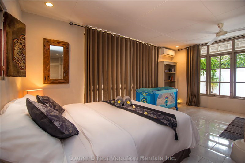 Master Bedroom 1. Queen Size Bed, Sofa, Massage Table Bathroom Bathtub, Shower, Toilets Bookshelf - Pool View. With a Crib.