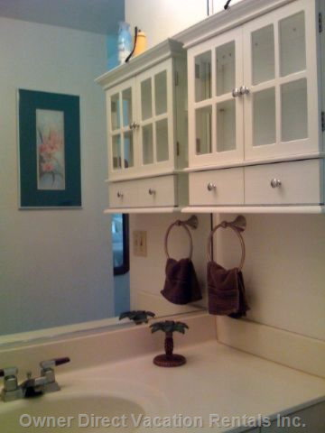 Bathroom Vanity with Plenty of Room for Toiletries off of the Sink:)