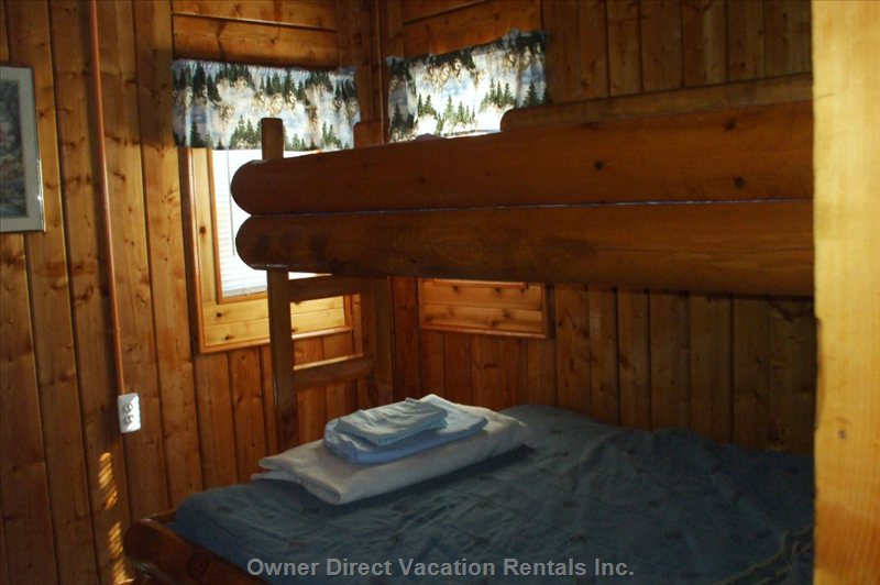 1 Bedroom ,has a Full Size Bed and a Twin Bunk , we Supply Sheets, Pillows , Comforters