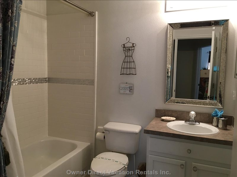 Brand New Bathroom with Shower over Tub Plenty of Hot Water so you Can Chill after a Day in the Parks