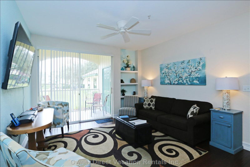 "Light and Airy Living Area with 46"" Tv, Queen Sofa Bed, Extra Chairs, Ceiling Fan and Air Conditioning"