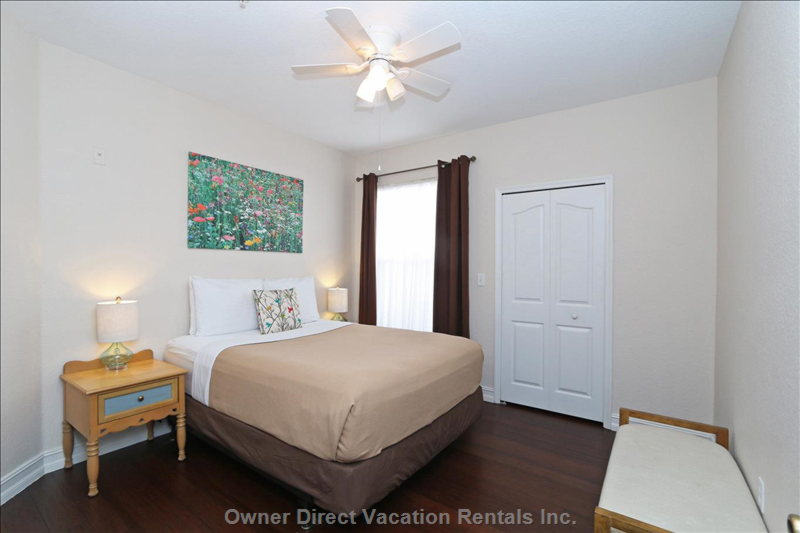 Bedroom 2 with Queen Bed, Walk in Closet, Large Tv, Chest of Drawers, Ceiling Fan and Air Conditioning