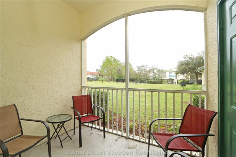 Screened Balcony.  The View across the Lawns is of the Children's Playground