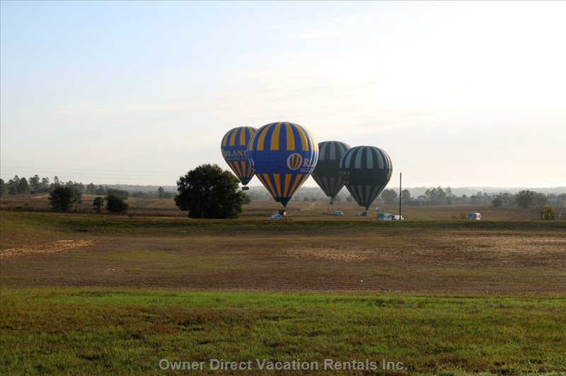 Hot Air Balloons Prepare to Fly over the Lake