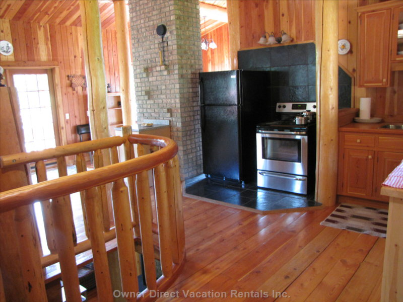 Full Kitchen - Nestled between Log Pillars and Spiral Stairs
