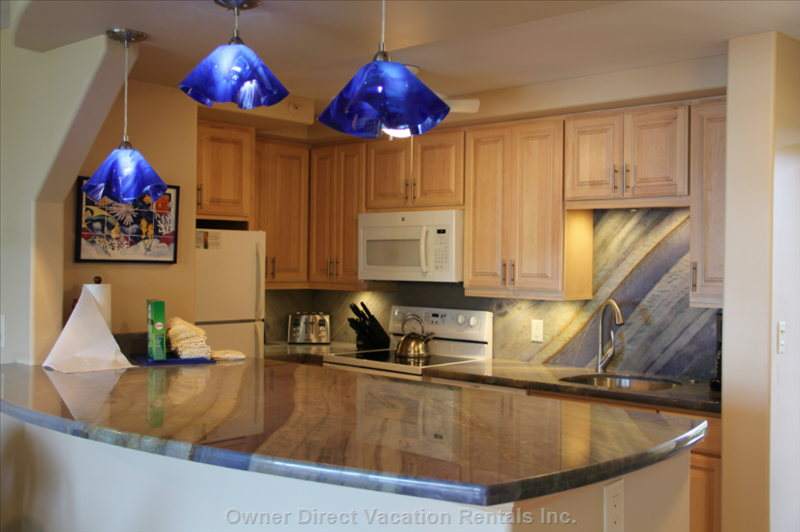 Our Completely Remodeled Kitchen with Quartzite Countertops and Backsplash and Solid Maple Cabinets