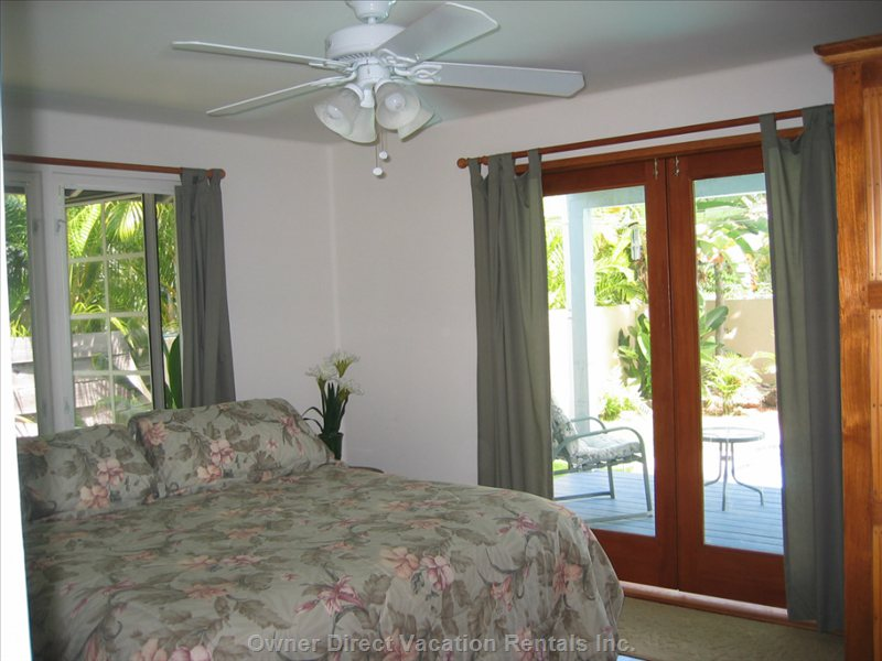 Master Bedroom with Doors to Deck and Pool Area