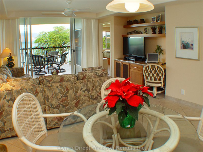 Dining Area Looking Thru Living Room to our Lanai, the Ocean and West Maui Mountains.