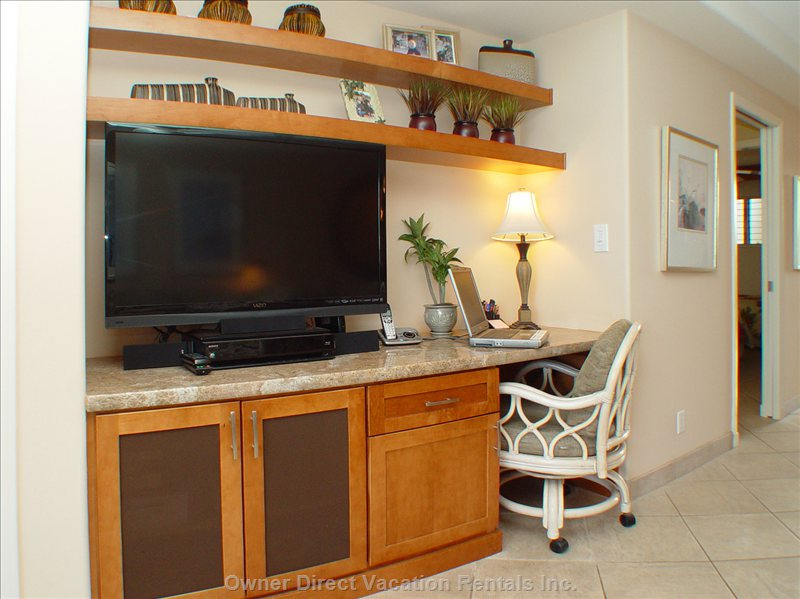"Desk Area. 42"" Led TV, Home Theatre and Blu-ray Player. - High Speed Internet is Always on for your Laptop and a Printer is Here for your Use. a Booming Sub-woofer is behind the Speaker Fabric Doors."