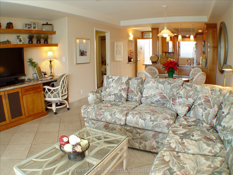Living Room Looking Back to Dining, Second Bedroom, Kitchen and Entry.