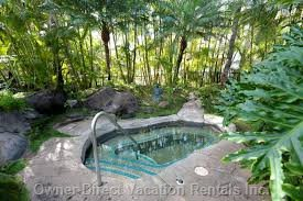 Tropical Hot Tub Next to Tropical Pool with Water Falls.  One of Two Pools and Hot Tubs.