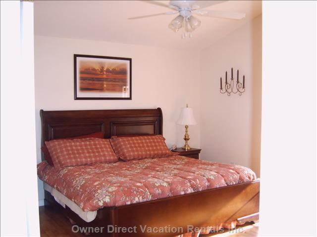Large Master Bedroom with King Bed and French Doors to Pool