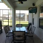 Lanai Dining Area with Lcd Tv and Sonos Music Speakers. Also has Gas Outdoor Cooking Grill.