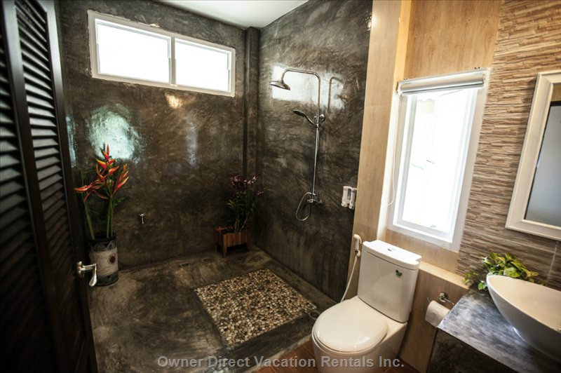 Spacious Bathroom with Rain Head Shower, Bath Tub and Free Toiletries.