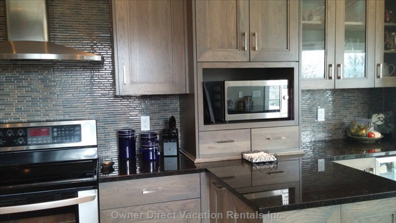 Gourmet Kitchen with Stainless Steel Appliances, Granite Countertops and Tile Floors