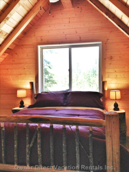 The Loft Bedroom has a Queen Size Log Bed and a Great View of the Forest