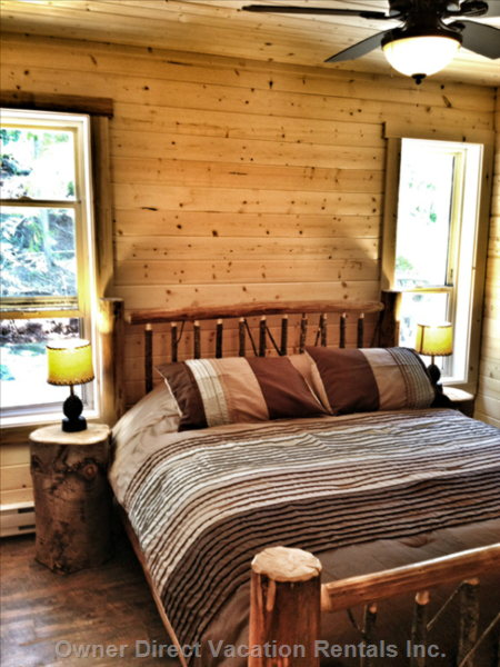 The Main Floor Bedroom has a Queen Size Log Bed