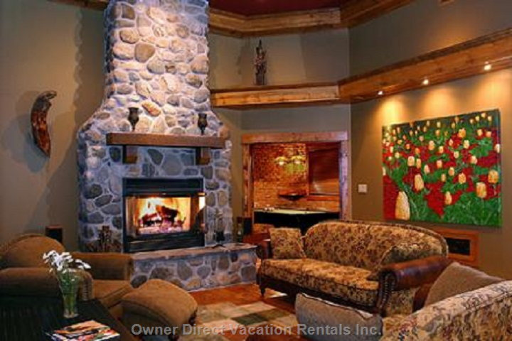 Living Room with Wood Burning Fireplace and 14 Foot Ceilings