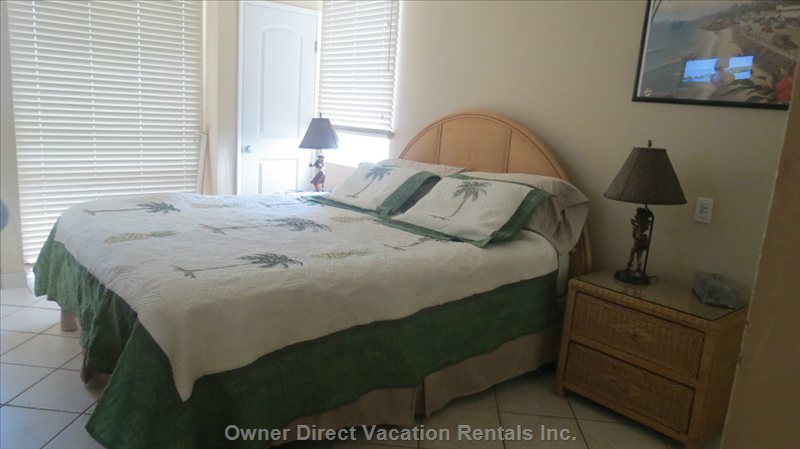 Large Bedroom with Comfortable California King Bed. Six Drawer Dresser plus 2 Night Tables. Ceiling Light and Fan, 2 Lamps and Tv/Dvd.