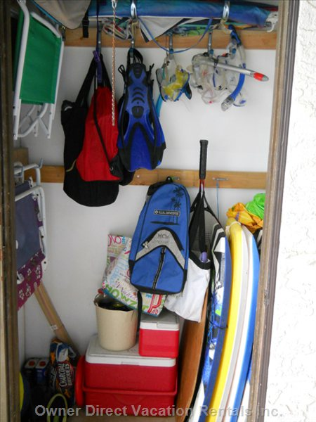 Lanai Storage Closet with a Variety of Boogie Boards, Snorkel Gear, Lawn Chairs, Coolers for your Use.