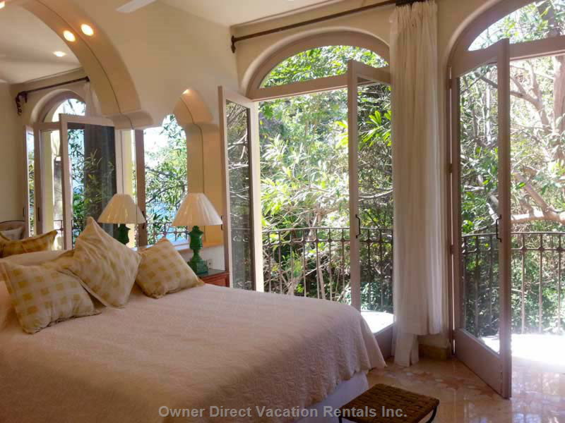 Bedroom with Queen Bed, Jungle View and Partial Ocean View