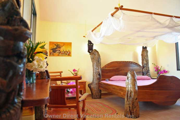 Bedroom Tsavo - all Bedrooms with En-suite Bathroom, King Size Bed, Handmade African Furniture and Fans Or Ceiling Fan. 3 Bedrooms Additionally with Modern Split Air-con.