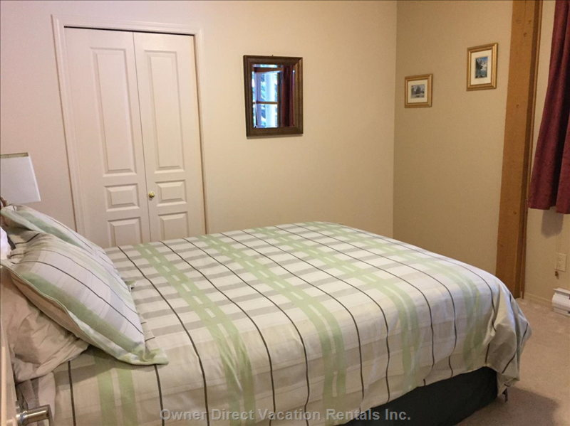 Lower Level Queen with Full Bathroom Immediately Adjacent.