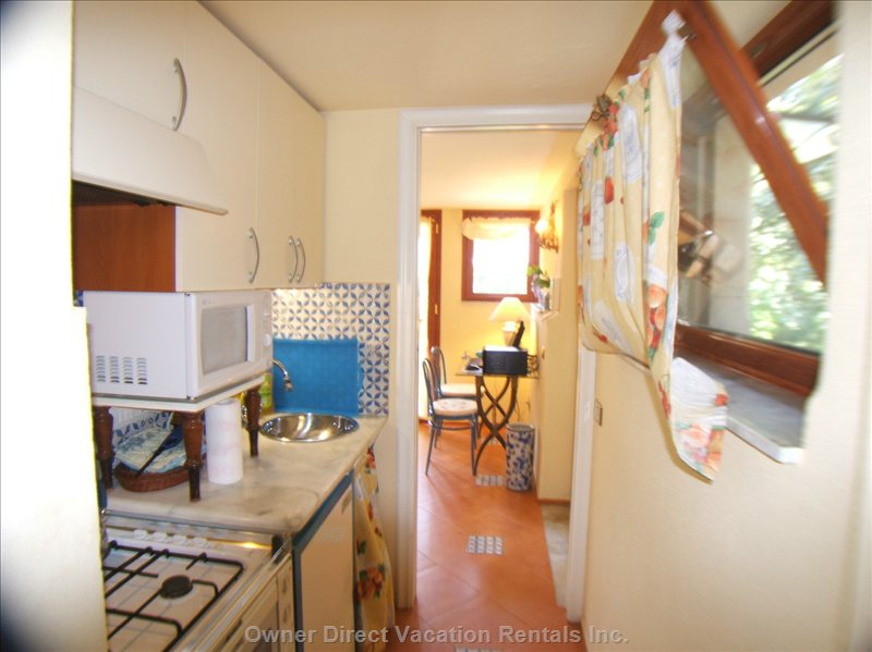 Small Yet Fully Equipped Kitchen - (Fridge, Microwave, Electric Oven, Dishwasher, Gas Cooker).