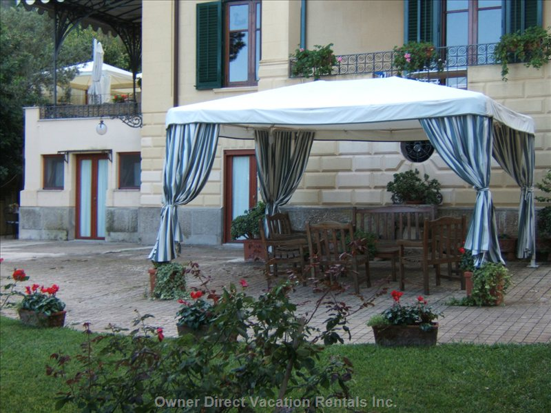 Large Gazebo Furnished with Arm Chairs and Sofa