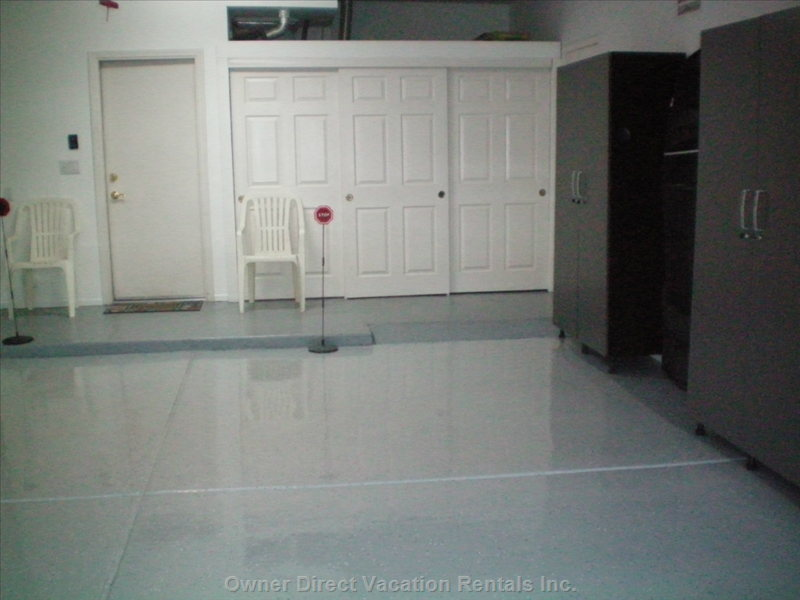 Garage, with Work Bench and Tools, Storage Cabinets, and Epoxy Floor.