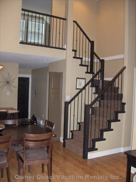 "Staircase Leading Upstairs to a Cozy Loft Appointed with Comfortable Seating, T.V. And Full Bathroom - Great ""Get Away"" Space!"