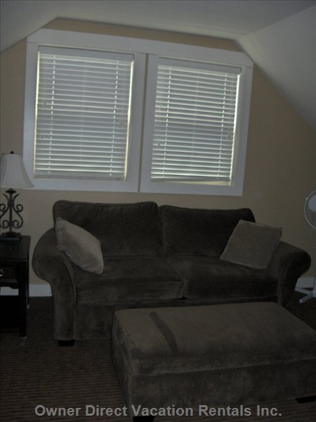Comfortable Couch Seating in Loft.  Relax, Kick Back, Watch a Movie, Enjoy a Novel Or Play some Games!