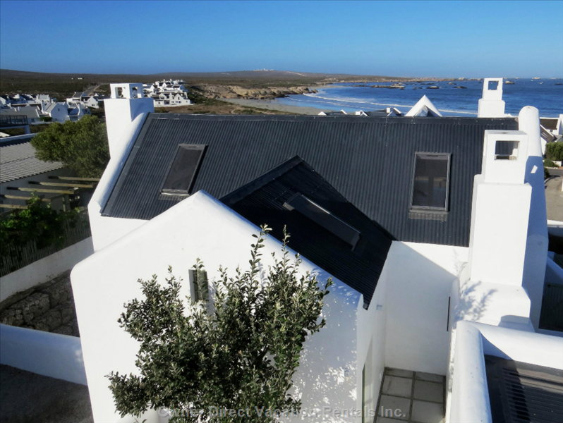 Front and Top of Cottage with Bekbaai Beach 100m in the Distance, Lighthouse at the Horizon