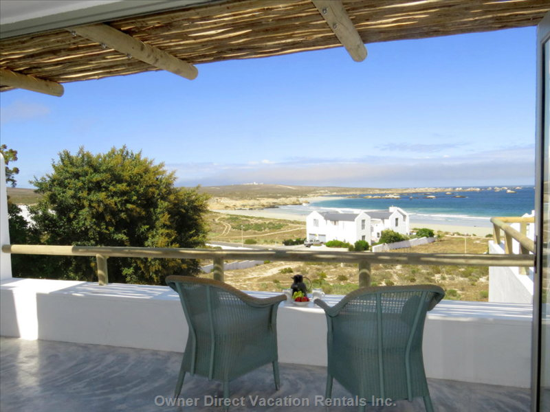 View from the Living Room across Bekbaai to the Cape Columbine Lighthouse