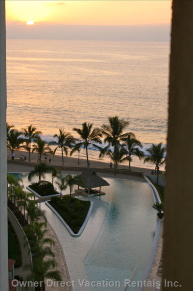 Overlooking  the Pool at Sunset, Showing Only Part of the Huge L Shaped Pool.